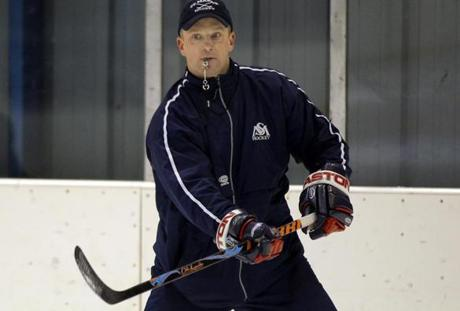 St. Marks varsity hockey head coach Scott Young runs practice in Southborough, Massachusetts, Friday January 7, 2011. Photo by Adam Hunger for The Boston Globe. Library Tag 01132011 Globe West 1
